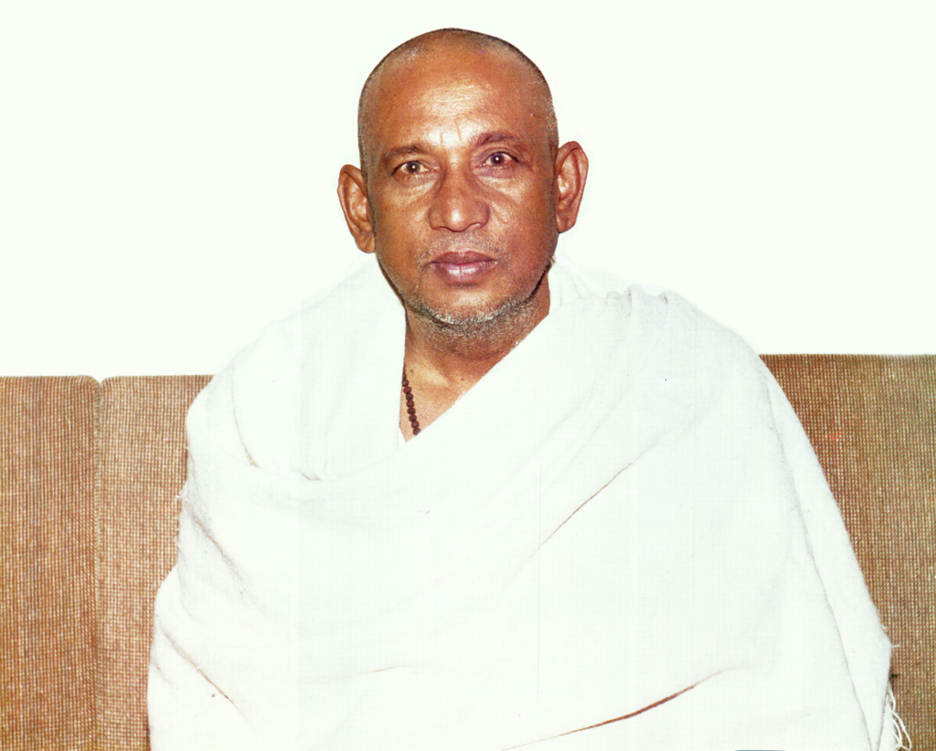 Portrait of Aghoreshwar Bhagwan Ramji sitting on couch